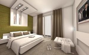 zielona tapeta na scianie w sypialni